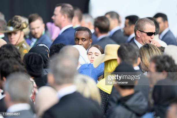New Zealand Prime Minister Jacinda Ardern hugs a member of the Muslim community at the end of the National Remembrance Service on March 29 2019 in...