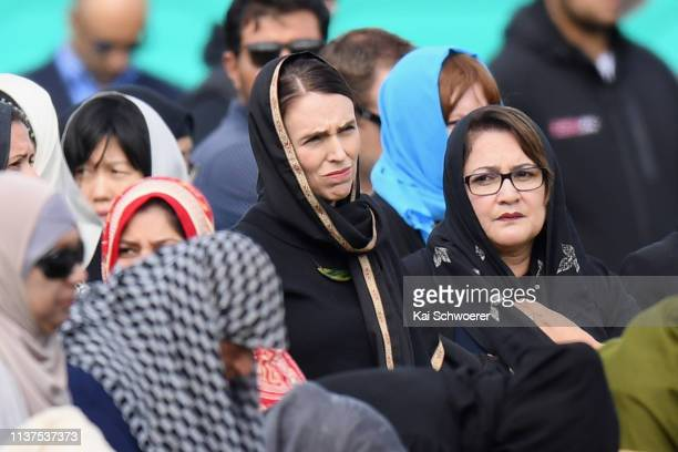 New Zealand Prime Minister Jacinda Ardern looks on as she attends Islamic prayers in Hagley Park near Al Noor mosque on March 22 2019 in Christchurch...