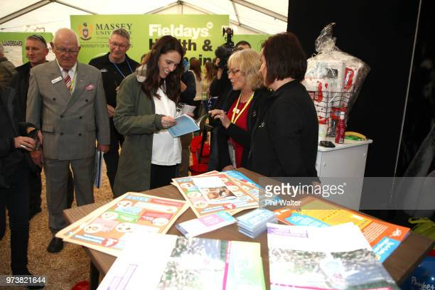 New Zealand Prime Minister Jacinda Ardern looks over the Plunket stall during a walkabout at the Mystery Creek Fieldays on June 14 2018 in Hamilton...