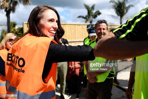 New Zealand Prime Minister Jacinda Ardern meets with builders and construction workers at a building site in Birkenhead on October 02, 2020 in...