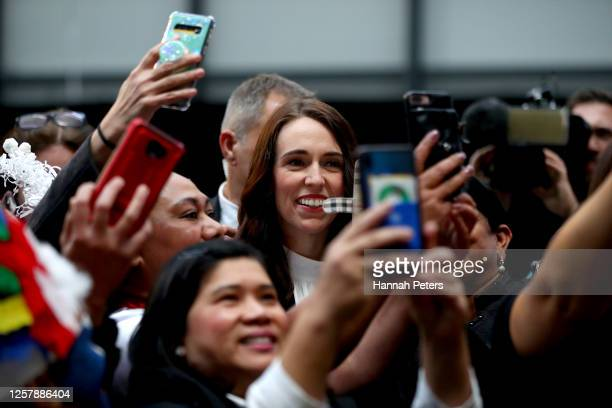 New Zealand Prime Minister Jacinda Ardern poses for photos after officially opening the Fisher and Paykel Healthcare's Daniell Building on July 24...