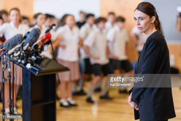 New Zealand Prime Minister Jacinda Ardern reacts as students perfom a Haka during her visit to Cashmere High School which lost two students during a...