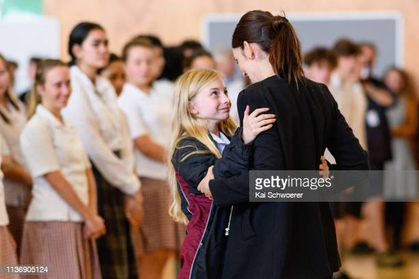 New Zealand Prime Minister Jacinda Ardern receives a hug from a student during her visit to Cashmere High School which lost two students during a...