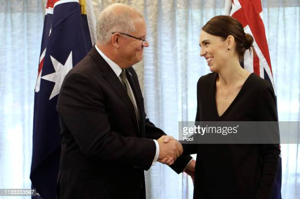 New Zealand Prime Minister Jacinda Ardern, right, shakes hands with Australian Prime Minister Scott Morrison at a bilateral meeting following a...