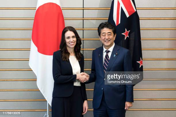 New Zealand Prime Minister Jacinda Ardern shakes hands with Japan's Prime Minister Shinzo Abe prior to their meeting on September 19 2019 in Tokyo...