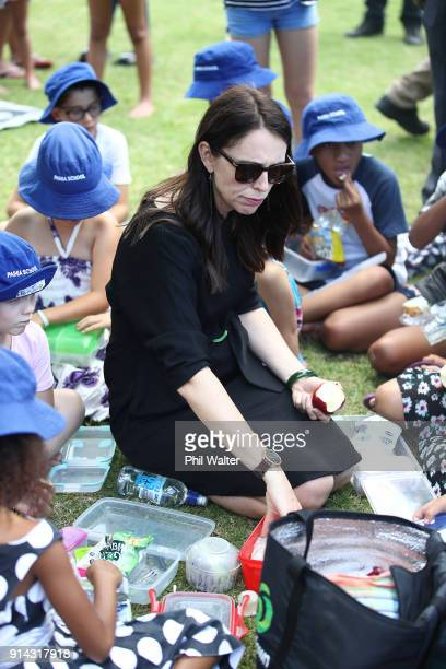 New Zealand Prime Minister Jacinda Ardern shares a picnic with children from Paihia Primary School on February 5 2018 in Waitangi New Zealand The...