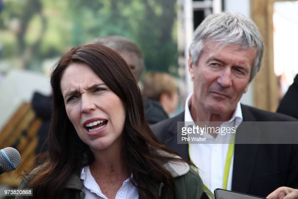 New Zealand Prime Minister Jacinda Ardern speaks as Minister of Agriculture Damien O'Connor looks on during the Mystery Creek Fieldays on June 14...