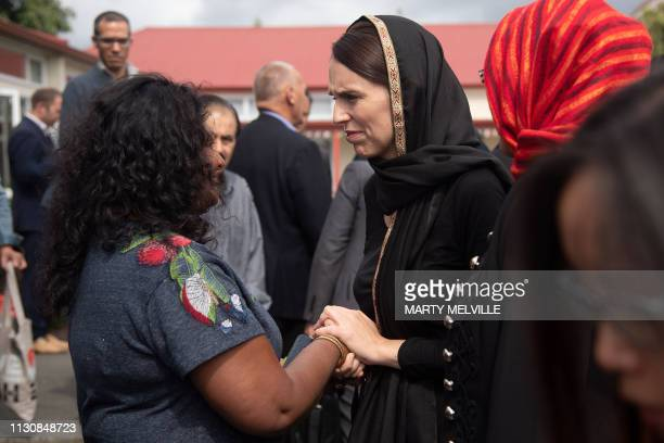 New Zealand Prime Minister Jacinda Ardern speaks with a woman during a visit to the Canterbury Refugee Centre in Christchurch on March 16 2019 A...
