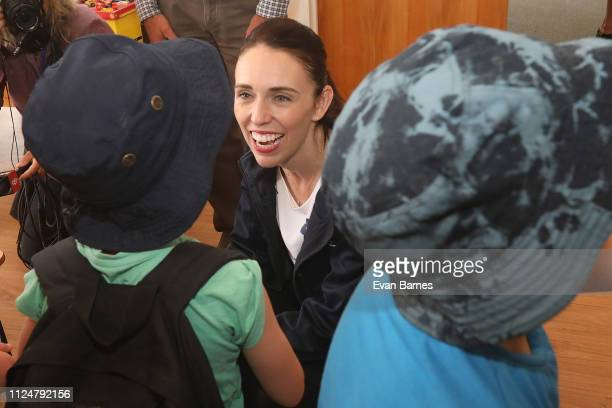 New Zealand Prime Minister Jacinda Ardern speaks with children from Wakefield School as she tours fire affected communities on February 14 2019 in...