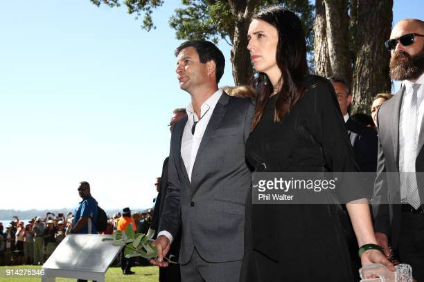 New Zealand Prime Minister Jacinda Ardern stands alongside her partner Clarke Gayford as they recieve a traditional Powhiri onto the Waitangi Treaty...