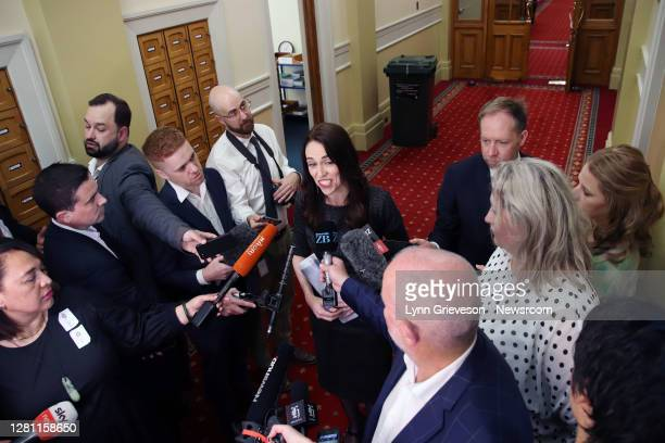 New Zealand Prime Minister Jacinda Ardern talks to press gallery reporters on October 20, 2020 in Wellington, on the way to the first Labour Party...