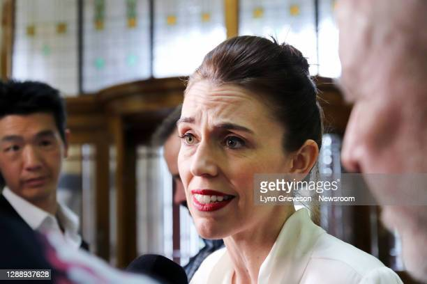 New Zealand Prime Minister Jacinda Ardern talks to reporters on her way to the debating chamber for the declaration of a Climate Emergency on...