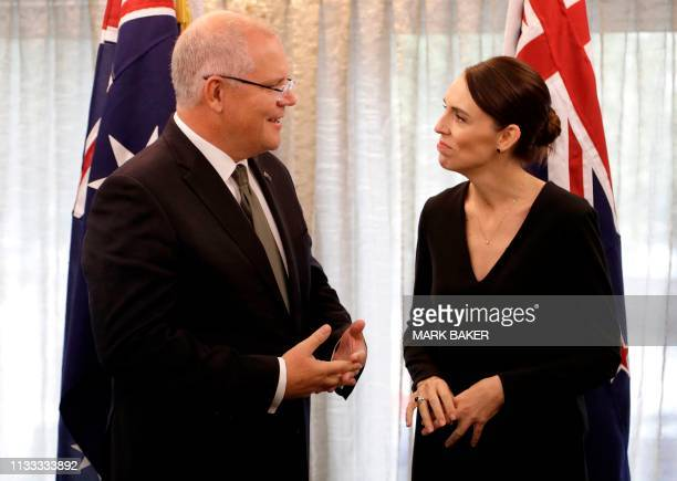 New Zealand Prime Minister Jacinda Ardern talks with Australian Prime Minister Scott Morrison at a bilateral meeting following a national remembrance...