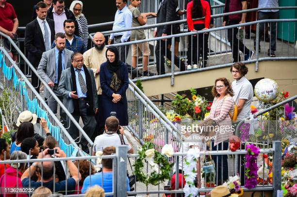 New Zealand Prime Minister Jacinda Ardern visits a makeshift memorial at the Kilbirnie Mosque on March 17 2019 in Wellington New Zealand 50 people...