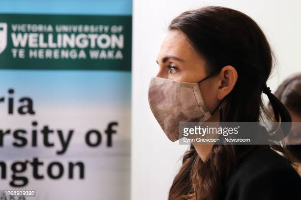 New Zealand Prime Minister Jacinda Ardern wears a fabric face mask at the Malaghan Institute of Medical Research on August 27, 2020 in Wellington,...