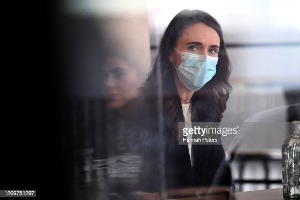 New Zealand Prime Minister Jacinda Ardern wears a mask during a visit to Crave Cafe on August 31, 2020 in Auckland, New Zealand. Face coverings are...