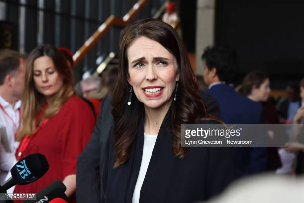 New Zealand Prime Minister Jacinda Ardern winces as she speaks to reporters at a Labour Party Election rally at the Michael Fowler Centre on October...