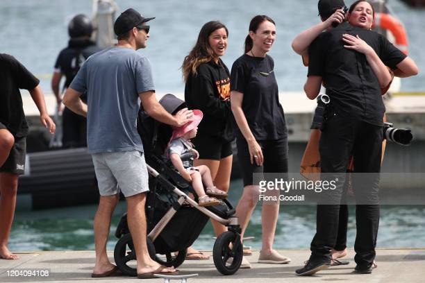 New Zealand Prime Minister Jacinda Ardern with her daughter Neve Gayford and partner Clarke Gayford after she joined the the crew on the Te Whanau...