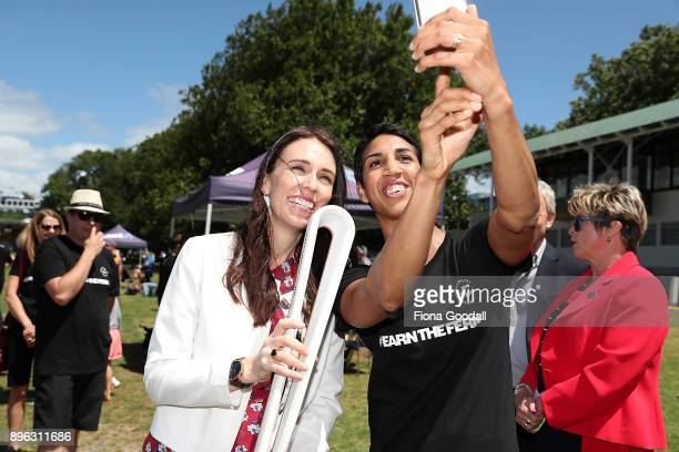 New Zealand Prime Minister Jacinda Ardern with the Queens Baton and boxer Alexis Pritchard during the Queens Baton Relay at Victoria Park on December...