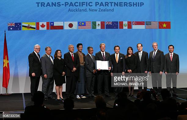 New Zealand Prime Minister John Key and Ministerial Representatives from 12 countries pose for a photo after signing the TransPacific Partnership...