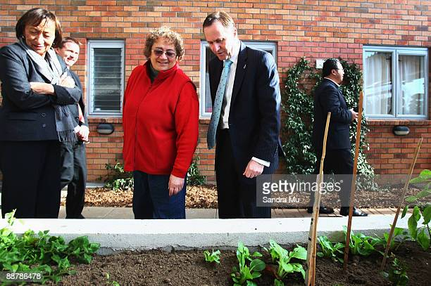 New Zealand Prime Minister John Key and National MP Georgina te Heuheu are shown a vegetable garden grown inside a recently redeveloped state housing...