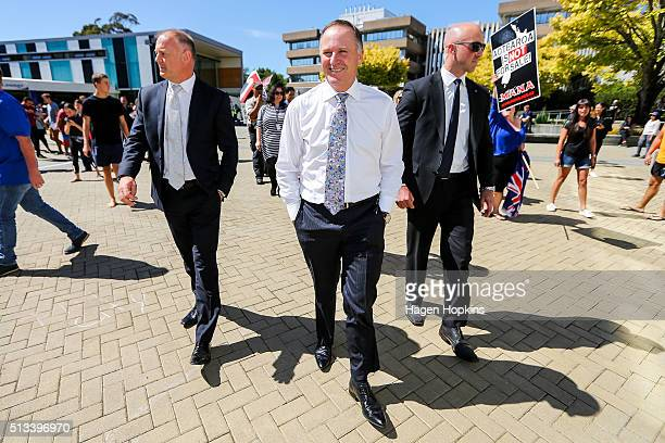 New Zealand Prime Minister John Key and National MP Jono Naylor look on during a visit to Massey University on March 3 2016 in Palmerston North New...