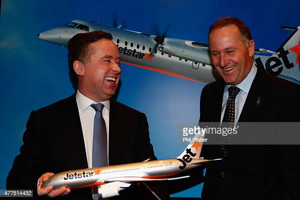 New Zealand Prime Minister John Key and Qantas chief executive Allan Joyce pose with a model plane at the Sofitel on June 18 2015 in Auckland New...