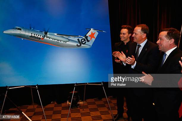New Zealand Prime Minister John Key and Qantas chief executive Allan Joyce unveil a picture of a Jetstar plane at the Sofitel on June 18 2015 in...