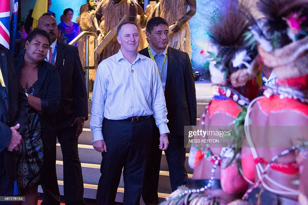 New Zealand Prime Minister John Key (C) arrives for the official opening of the 46th Pacific Islands Forum (PIF) in Port Moresby on September 8, 2015. The 16-nation grouping consists mainly of small island nations, together with Australia and New Zealand, with the two developed nations being accused of dragging their feet on climate change. AFP PHOTO/Ness KERTON
