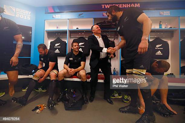 New Zealand Prime Minister John Key congratulates Samuel Whitelock in the dressing room following the 2015 Rugby World Cup Semi Final match between...