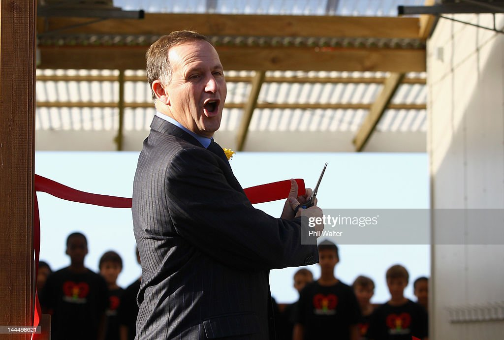 New Zealand Prime Minister John Key cuts the ribbon as he opens a new classroom block at the Westminister Christian School on May 15, 2012 in Auckland, New Zealand. The Prime Minister is conducting events in Auckland today before heading to Gisborne for appearances tomorrow.