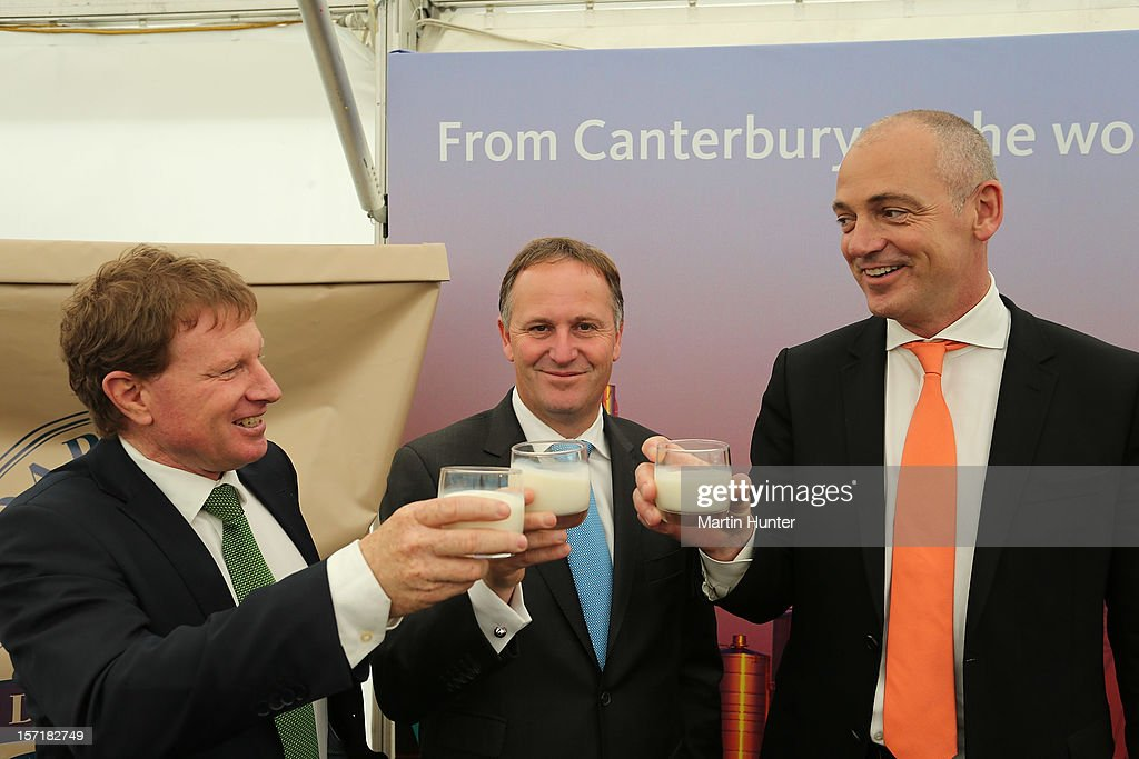 New Zealand Prime Minister John Key (C) drinks a glass of milk with John Wilson (L) Fonterra Chairman and Theo Spierings (R) CEO of Fonteera on November 30, 2012 in Darfield, New Zealand. Fonterra today is coinciding the opening of its new processing facility in Darfield with its release on the New Zealand Stock Exchange, launching with an expected NZD$550 million value.