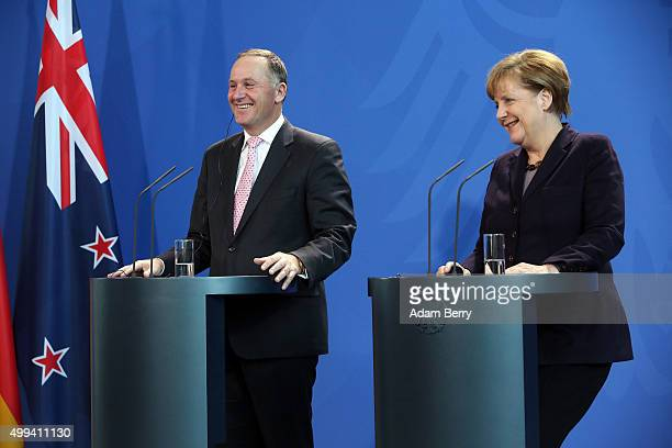 New Zealand Prime Minister John Key gives a press conference with German Chancellor Angela Merkel on December 1 2015 in Berlin Germany On the agenda...