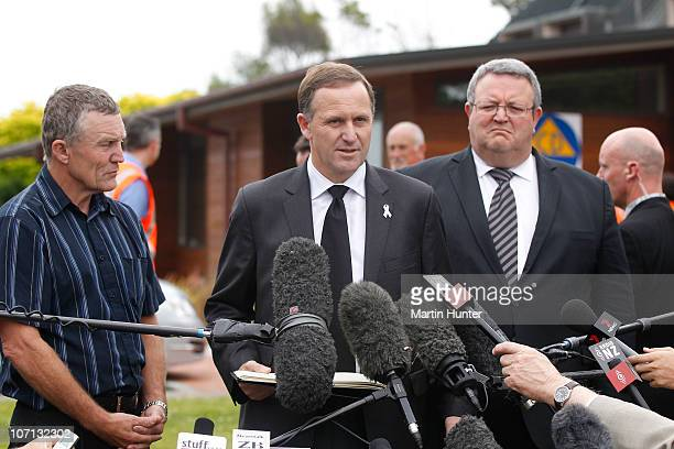 New Zealand Prime Minister John Key Greymouth Mayor Tony Kokshoorn and Energy Minister Gerry Brownlee speak at a press conference during a visit to...