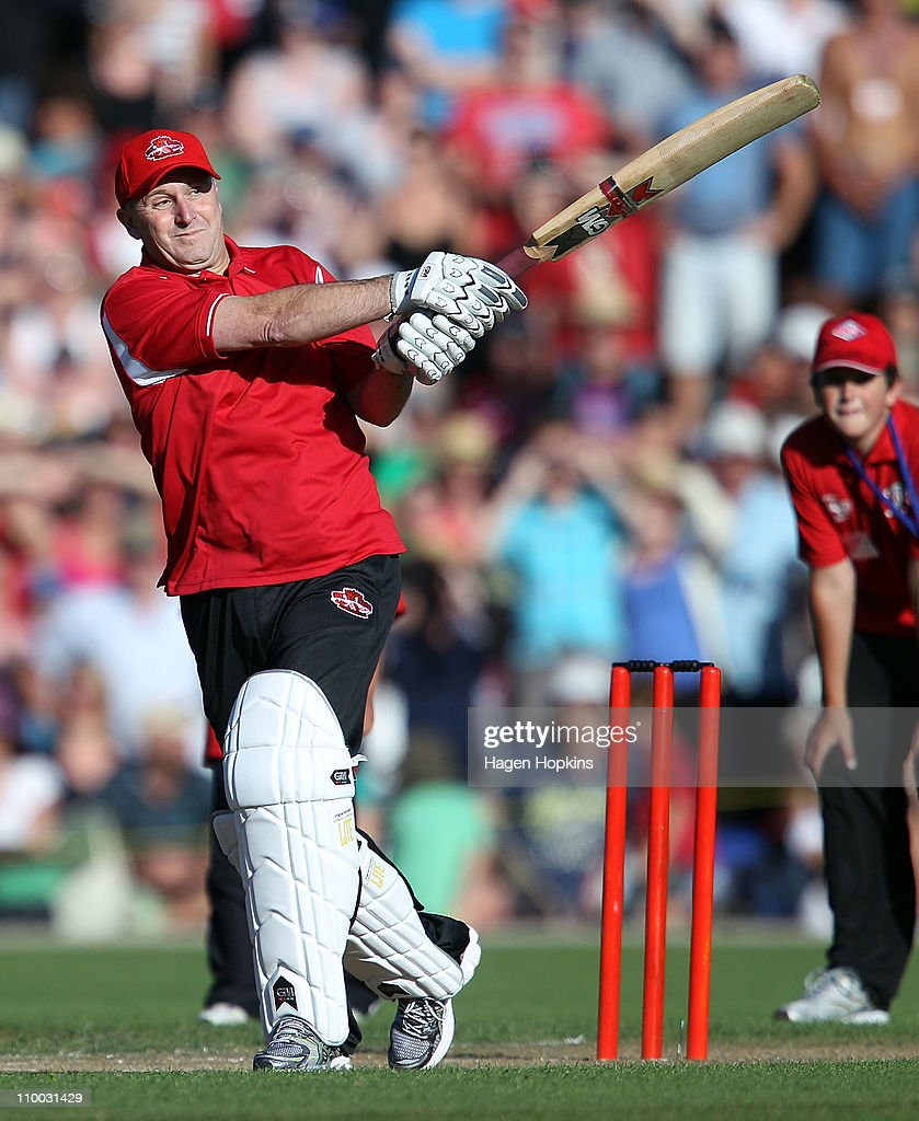 New Zealand Prime Minister John Key hits a four off the bowling of Shane Warne in their one on one challenge during the Christchurch Earthquake Relief Charity Twenty20 match at Basin Reserve on March 13, 2011 in Wellington, New Zealand.
