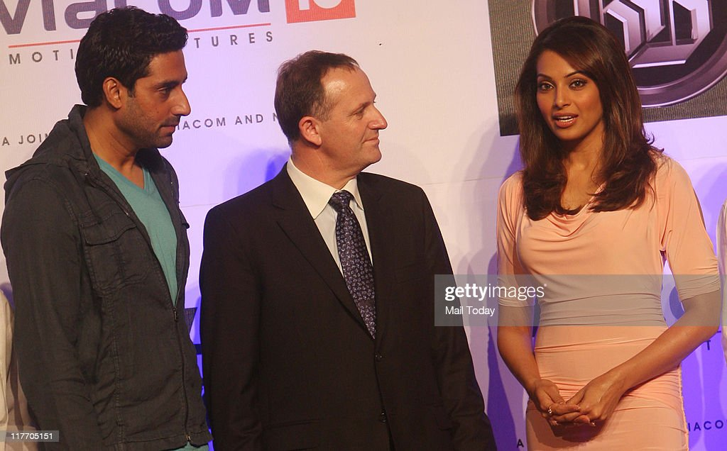 New Zealand Prime Minister John Key interacts with Abhishek Bachchan and Bipasha Basu on a set of the movie `Players` at the Goregaon film city in...