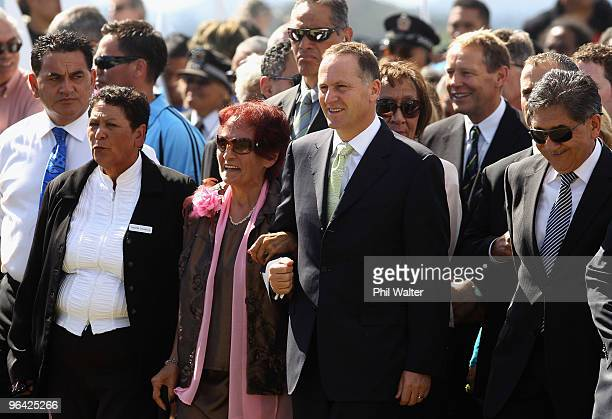 New Zealand Prime Minister John Key is guided by Titewhai Harawera a Ngapuhi elder as he is welcomed onto TeTii Marae on February 5 2010 in Waitangi...