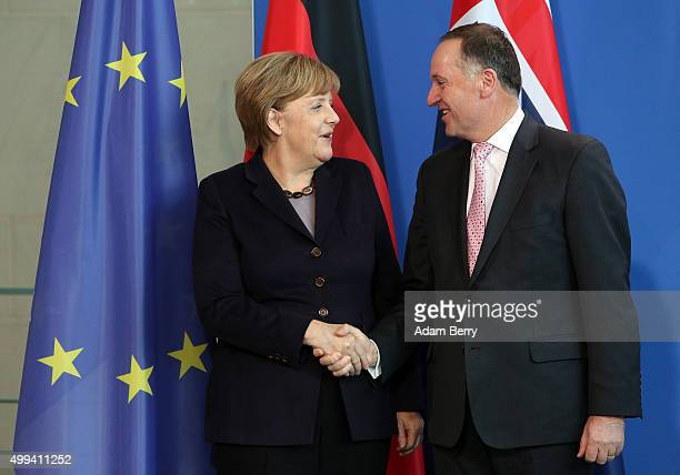 New Zealand Prime Minister John Key leaves a press conference with German Chancellor Angela Merkel on December 1 2015 in Berlin Germany On the agenda...