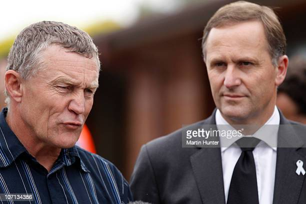 New Zealand Prime Minister John Key listens to Greymouth Mayor Tony Kokshoorn speak at a press conference during a visit to Greymouth to meet with...