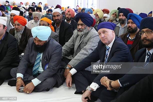 New Zealand Prime Minister John Key looks on during a visit to Sikh Temple 'Gurudwara Sri Dasmesh Darbar' in Papatoetoe on August 17 2014 in Auckland...