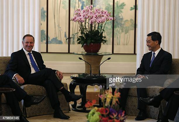 New Zealand Prime Minister John Key meets with Hong Kong Chief Executive Leung Chunying during their meeting in Hong Kong on March 21 2014 AFP PHOTO...