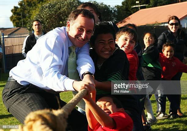 New Zealand Prime Minister John Key plays a game of Tug Of War with school children at the launch of a new school sports funding initiative from the...