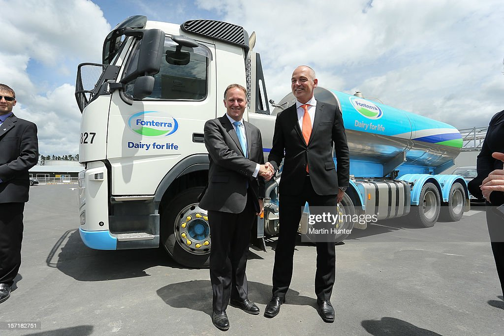 New Zealand Prime Minister John Key (L) poses with Fonterra CEO Theo Spierings after arriving on November 30, 2012 in Darfield, New Zealand. Fonterra today is coinciding the opening of its new processing facility in Darfield with its release on the New Zealand Stock Exchange, launching with an expected NZD$550 million value.