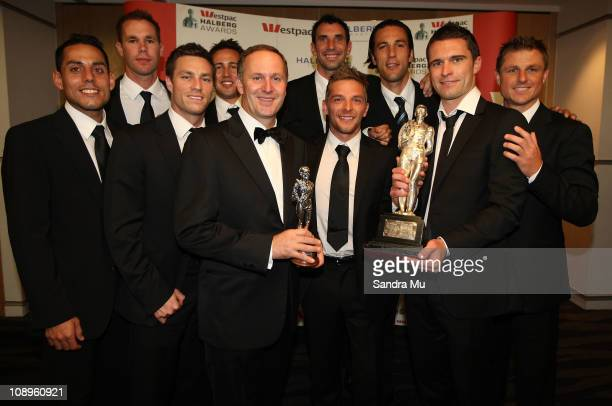 New Zealand Prime Minister John Key poses with the All Whites team after winning the supreme award during the Westpac Halberg Awards at the SkyCity...