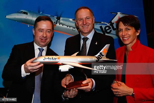 New Zealand Prime Minister John Key Qantas chief executive Allan Joyce and Jetstar Group CEO Jayne Hrdlicker pose with a model plane at the Sofitel...