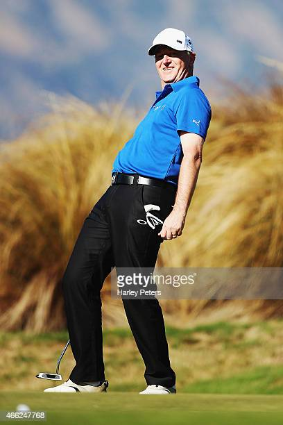 New Zealand Prime Minister John Key reacts after missing a putt during day four of the New Zealand Open at The Hills Golf Club on March 15 2015 in...