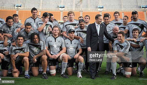 New Zealand Prime Minister John Key Richie McCaw of the All Blacks pose for a team photo during a New Zealand All Blacks Captain's Run at the...