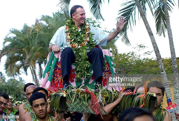 New Zealand Prime Minister John Key rides on a Pa'at held up by students from Avarua Primary School during the Opening Ceremony of the Pacific...