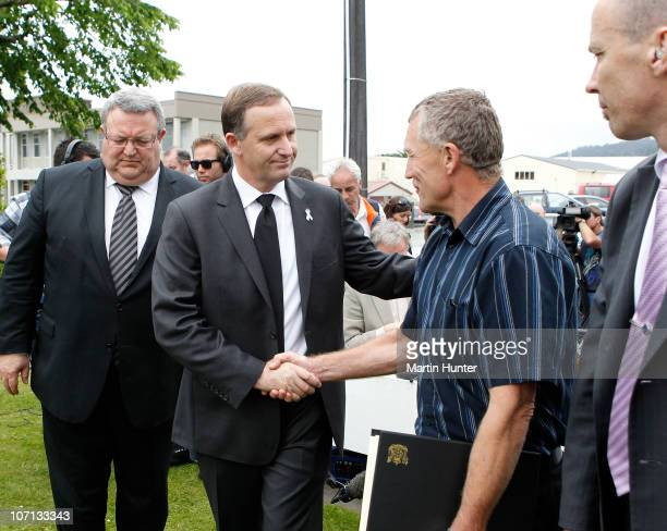 New Zealand Prime Minister John Key shakes hands with Greymouth Mayor Tony Kokshoorn after a visit to Greymouth to meet with families of the lost...