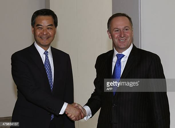 New Zealand Prime Minister John Key shakes hands with Hong Kong Chief Executive Leung Chunying during their meeting in Hong Kong on March 21 2014 AFP...